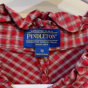 Red plaid button up shirt with ruffle collar